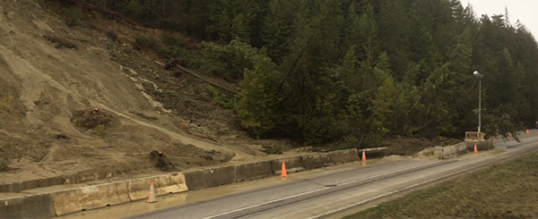 Mudslide caught on camera totally covers road