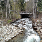 Water flows under ID-200B near Hope, Idaho.
