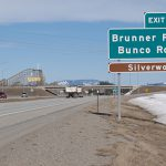 The sign shows the Bunco Road overpass on US-95 near Silverwood.