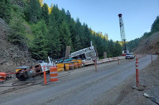Photo of crane that fell June 29, 2019 while installing a temporary bridge for US-95 construction in Culdesac Canyon Phase 2.