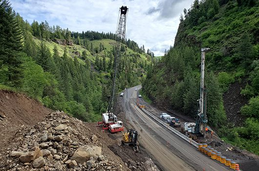 Two cranes help with 2019 construction of a passing lane in Culdesac Canyon just north of Winchester.