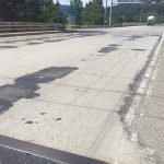 Deteriorating pavement on US-95 just north of Spokane River where it passes over Northwest Boulevard