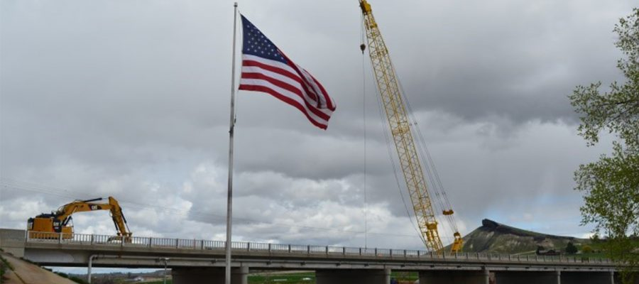 ID-55 bridge with american flag in foreground