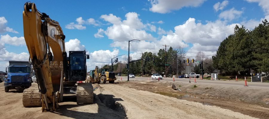 back hoe, loader, and semi truck near the intersection of Locust Grove and Chinden