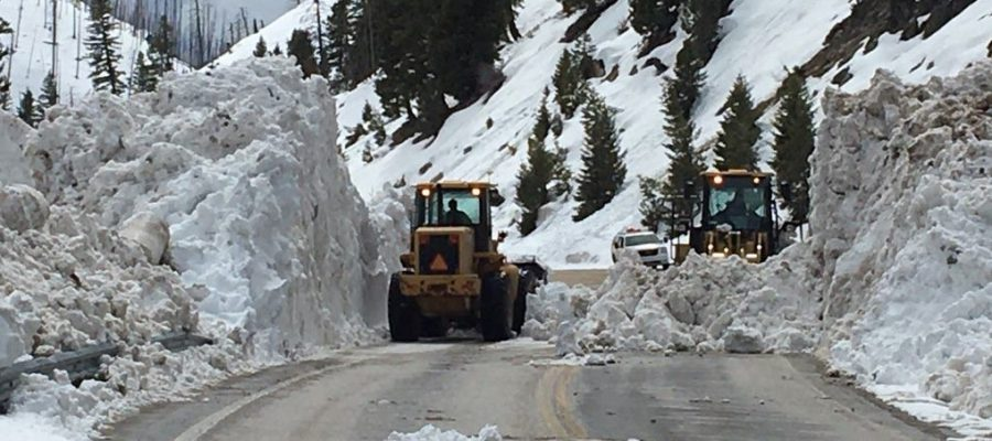 Two loaders clear an avalanche slide
