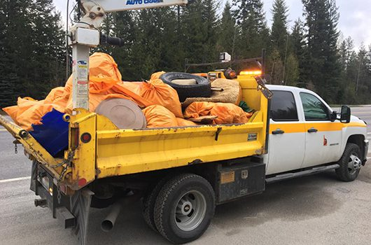 ITD truck loaded with bags of trash from an Adopt a Highway pickup