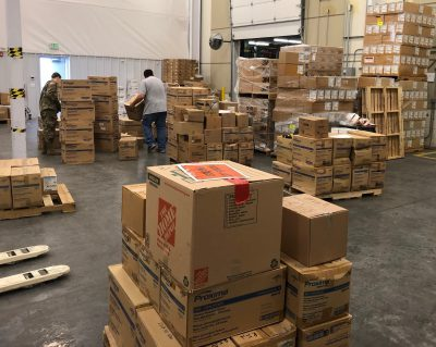 Staff sorts supplies for distribution