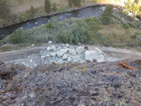 Photo from the top of the failing slope on US-95 at milepost 188 looking at massive boulders