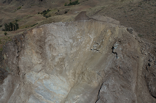 Photo of the slope above MP 188 on US-95 after blast