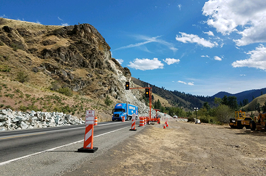A semi passes the temporary signal at the US-95 slide south of Riggins