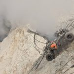 A driller works on the US-95 slide above MP 188