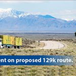 Graphic of truck on highway with text reading Comment on proposed 129k route