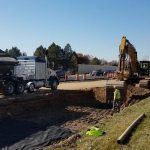 excavator besides roadway