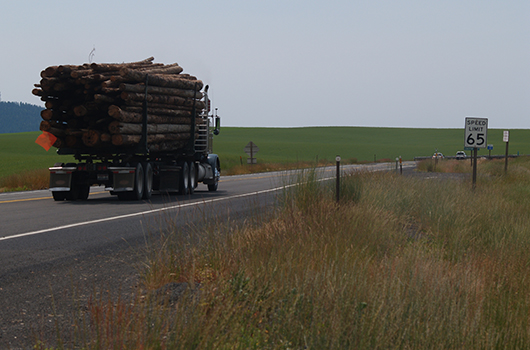 Log truck at top of the grade on US-95