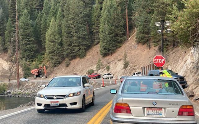 Cars stopped by flagger on Idaho Highway 55